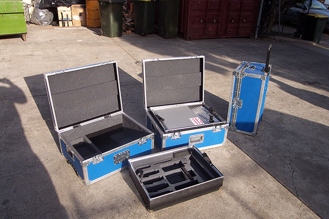 Light weight flight cases with polypropylene lift out trays with foam inserts to suit equipment